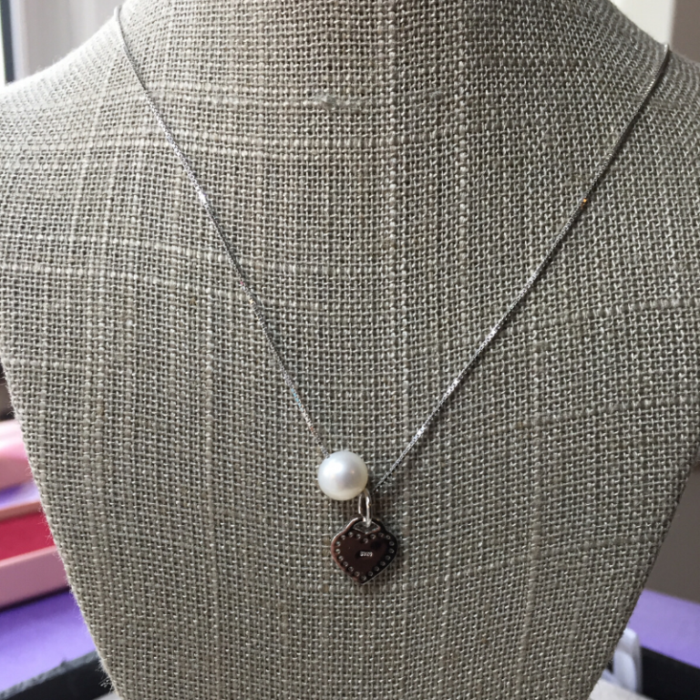 Pearl and heart pendant